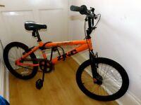 2 bikes for sale. Orange stunt BMX & Yellow mountain bike