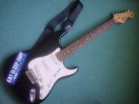 Squier Bullet Strat in black w/ tremolo arm, strap, new strings, case, and accessories