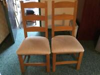Two Solid Oak Dining Chairs (seats are clean, it's the pile of the fabric). £10 each
