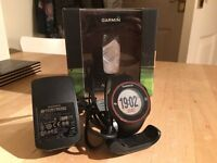 Garmin Approach S3 GPS golf watch with touchscreen on box with charger