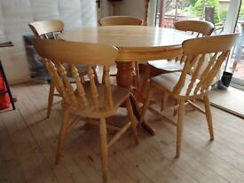 wooden round extendable dining table with chairs