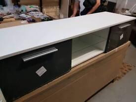 A brand new white x grey 2 door tv unit