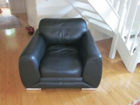 Black leather armchair, extremely comfortable.