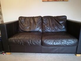 Brown leather cube style sofa and two chairs
