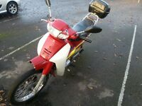 Warrior astrea urban 90 cc moped.