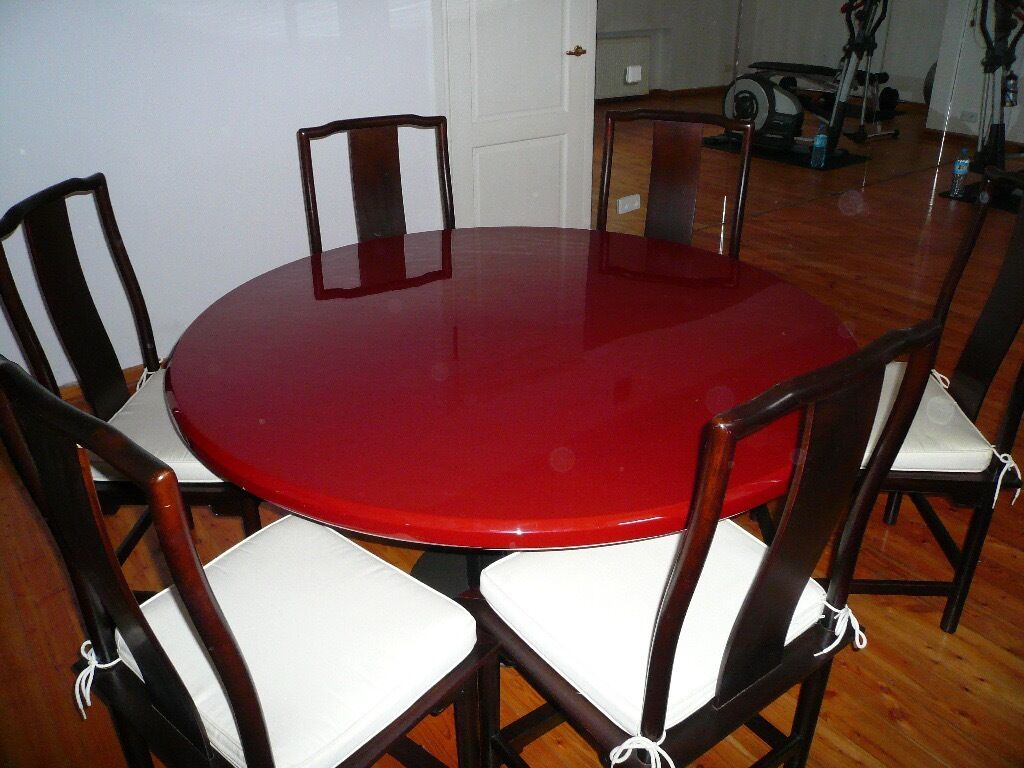 Red Lacquer Round Dining Table with 6 chairs diameter 140cmin Old Windsor, BerkshireGumtree - Elegant Red Laquer Table with Pedestal base Diameter of table top 140cm Very Good Condition 6 dark wood chairs with cushions also in good condition. Available for collection