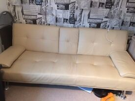 faux leather sofa bed, drop down drinks holder