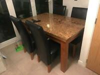 Table and chairs with granite top.