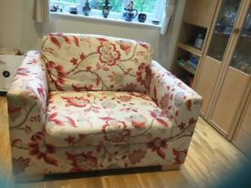 Snuggler arm chair