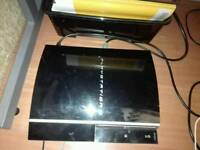 Ps3 for sale with 5 games and two pads