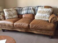3 Piece leather sofa suite with foot stool.