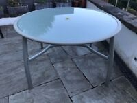 Glass top garden table with metal legs