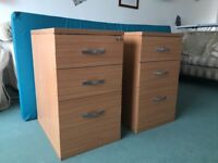 Under desk office draw sets wth file holding bars in the bottom draws.