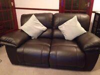 Two 2-seater brown leather recliner sofas