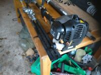 Petrol exstendable chainsaw with hedge trimmer attachment with safety guard as new used once