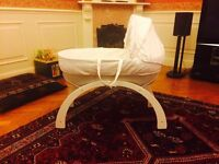 award winning moses basket with curve stand