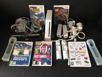 Nintendo Wii Console with 4 wii motes and 3 nunchucks plus 5 games