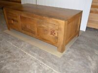 oak 6 drawer coffee table,,£85,may be able help with delivery.