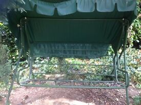 Swinging seat frame