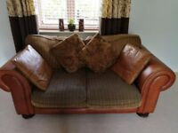 Barker and Stonehouse fabric and leather two seater sofa