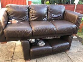 Brown leathers sofas