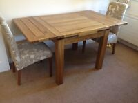Oak, extendable dining table + four dining chairs
