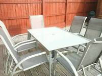 Garden patio set large table with 6 chairs ok condition