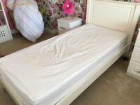 White wood single bed