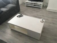 White TV stand and coffee table