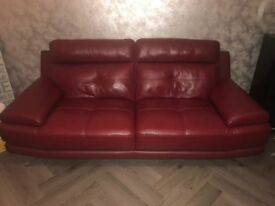 Red leather 3 seater sofa from Harvey's furniture store