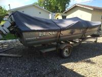 Lund fishing boat with 55 Johnson motor and trailer