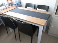 Pine Dining table and 4 chairs in Faux leather