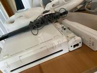 Wii console & Fit Balance board - 2 remotes- nunchuck