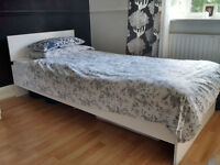 White Clean Single Bed Frame and Comfortable clean Expensive Mattress.