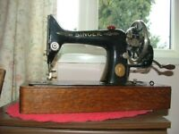 Table top Singer Sewing Machine with accessories. In good condition though old.