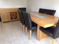 Dining table, six chairs and sideboard