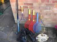 Job lot of stuff. Rackets,rugby ball,skates and a hockey stick
