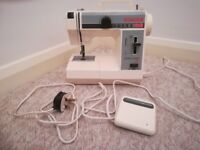 Singer 324 featherweight plus compact free arm electric sewing machine complete with carrying case