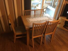 Wooden extended table And chairs .