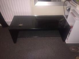 Black tv stand with glass top and glass middle section