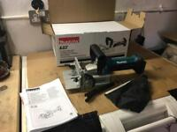 Makita biscuit jointer and accessories.