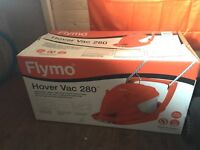 Flymo lawn mower - boxed