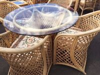 good condition, 4 chair cane glass topped table set, cane chair and table sets, cane outdoor set.