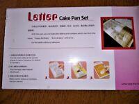 Adjustable letter cake tin.