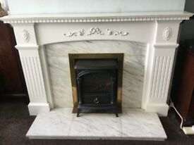 White fireplace and marble harth and back