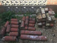 Reclaimed red bricks and topper £30 for all. 50p each