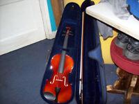 Violin with case.