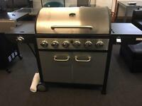 Brand New 6 Burner Gas Barbecue with storage underneath.