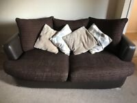 Brown two seater sofa and cuddler