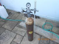 Welding gas cylinder with valve, spanner and flow gauge
